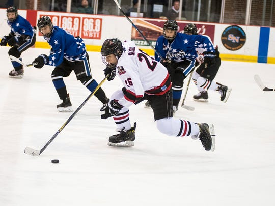 Jersey Shore Wildcats' Nathaniel Block (26) skates down the ice with the puck during their Silver Stick Finals BAA-C match at McMorran Arena Jan. 19.