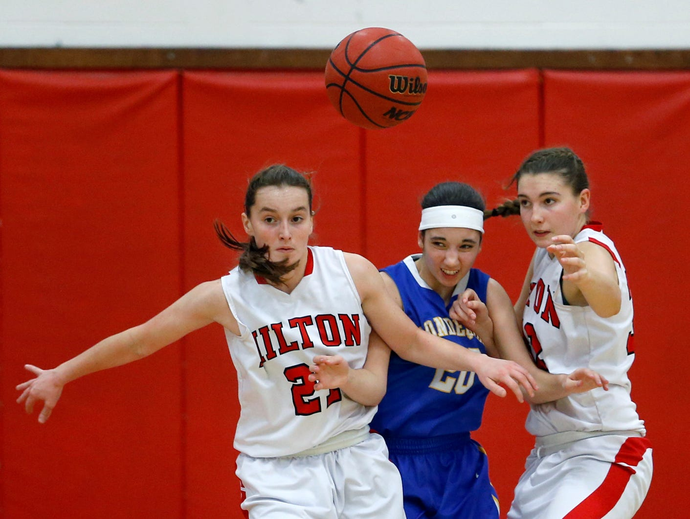 Hilton's Alyssa Juergens, Irondequoit's Megan Dano and Hilton's Meaghan McGwin chase a loose ball in the first quarter at Hilton High School.