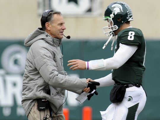 Mark Dantonio shakes hands with Kirk Cousins as Cousins comes out of the game during a 55-3 victory over Indiana on Nov. 19, 2011.
