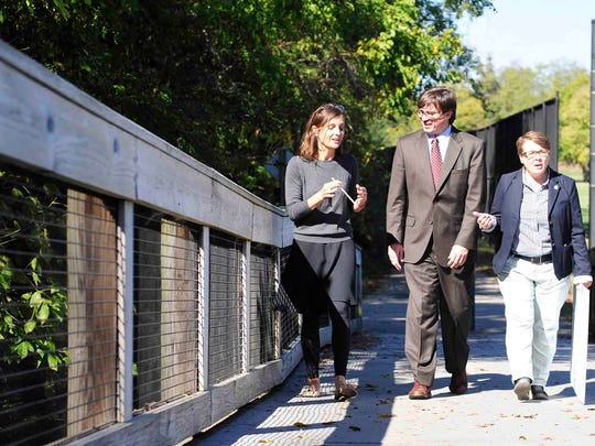 Mekayle Houghton, executive director of Cumberland River Compact; District 24 council member Jason Holleman; and Gina Hancock, state director of The Nature Conservancy, walk on the Richland Creek Greenway to put up a sign announcing the removal of the dam.