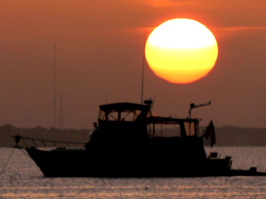 Sunrise over Pensacola Beach found a few boaters that