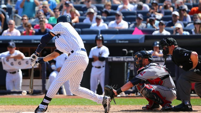 Yankees shortstop Derek Jeter singles in the sixth inning of Saturday's game against the Indians for his 3,431st hit and sole possession of sixth place on baseball's all-time hits list.