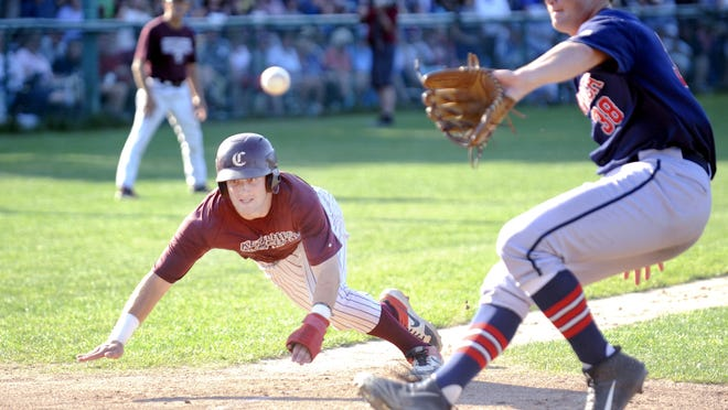 Casey Schmitt of the Cotuit Kettleers dives safely for home as reliever Carson Seymour of the Harwich Mariners covers in a game last August. The Cape Cod Baseball League canceled its season April 24, forcing fans to miss out on college baseball's premier league for the first time since World War II wiped out the 1945 schedule.