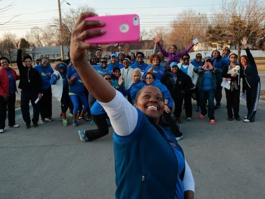 GirlTrek Detroit captain Chrysantha Norwood, center,