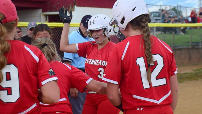 Riverheads' Leah Lester celebrates with her teammates as she steps on home after hitting a solo home run in the bottom of the sixth inning against Windsor during their VHSL Class 1 state softball quarterfinal at Riverheads High School in Greenville, Va., on Tuesday, June 5, 2018. Lester's homer was the difference in the Gladiators' 2-1 victory.