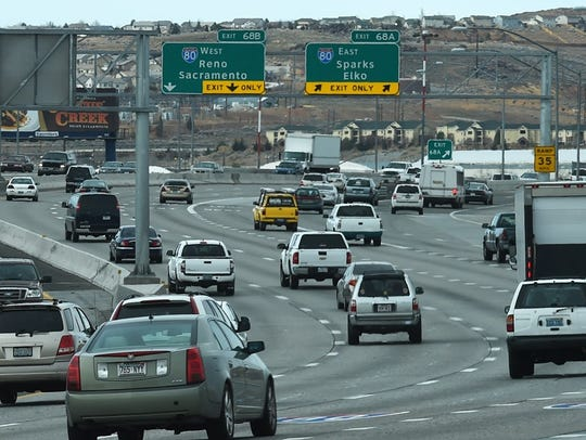 A file photo showing traffic moving north on Interstate 580 near the Spaghetti Bowl in Reno.