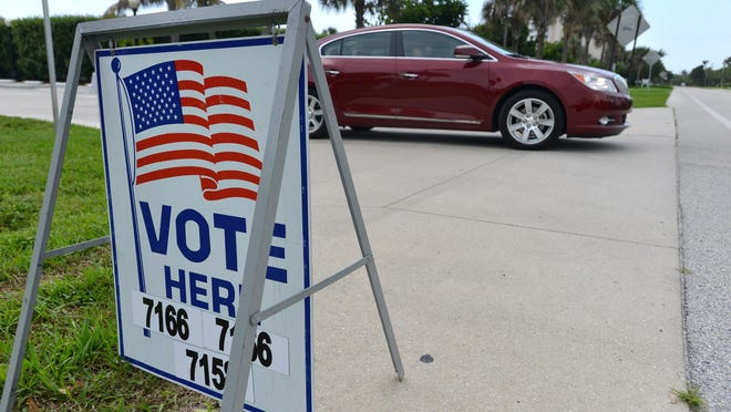 Voters leave the South Fire-Rescue Station after casting their votes during a recent election.