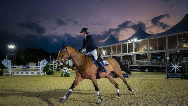 USA's Caitlin Creel riding Liberty Son finishes the first phase of the $5,000 CSI2* Northstar Tour at the 2020 Palm Beach Masters in Wellington, Jan 29. Creel placed 23rd in the first ever class held under the lights at Deeridge Farms. The event was part of the brand new Sunset Challenge, which features competition under the lights in the evening hour.