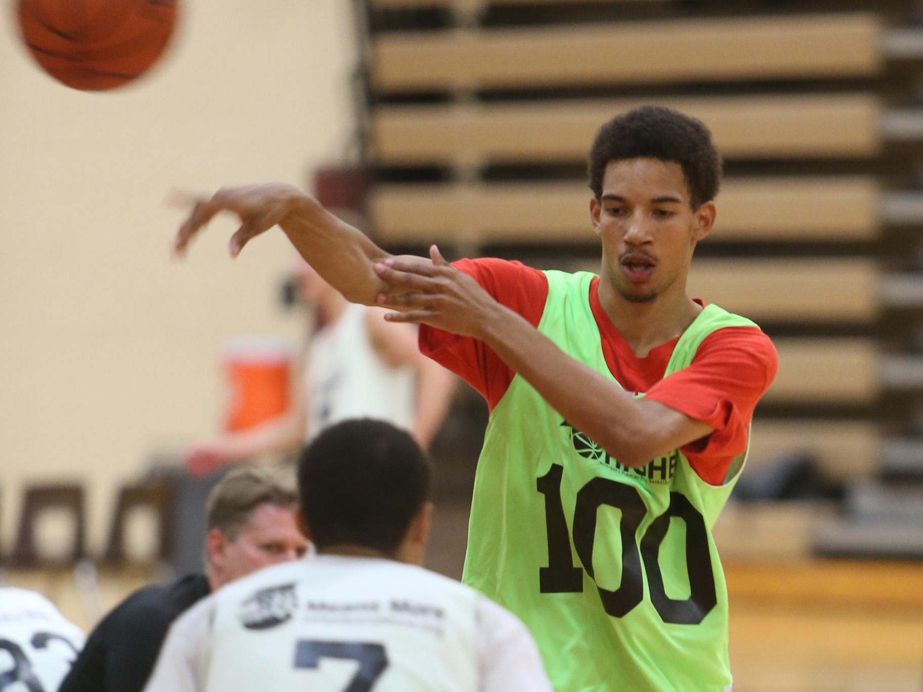 Flint Beecher senior Delon Willis competes during the Reaching Higher annual basketball camp Wednesday at Milford High School.