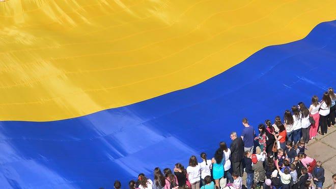Ukrainians hold a giant national flag in Chernivtsi, Ukraine, on May 19, 2014.