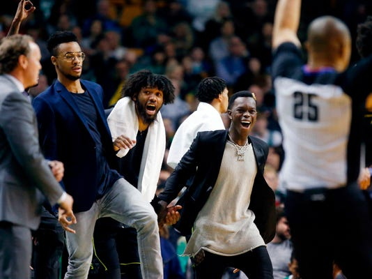 The Atlanta Hawks bench reacts to a three-point basket during the third quarter of an NBA basketball game against the Boston Celtics in Boston, Sunday, April 8, 2018. (AP Photo/Michael Dwyer)