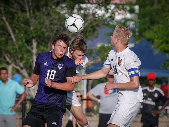 Waukee junior Zach Eaton heads the ball toward the net in Waukee's winning drive in overtime against Valley in Class 3A during the 2018 boys state soccer tournament at Cownie Soccer Complex in Des Moines on Thursday, May 31, 2018.