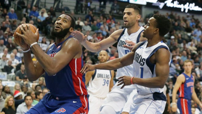 Pistons center Andre Drummond, left, drives past Mavericks defenders Dennis Smith Jr. (1) and Salah Mejri (50) during the first half on Wednesday.