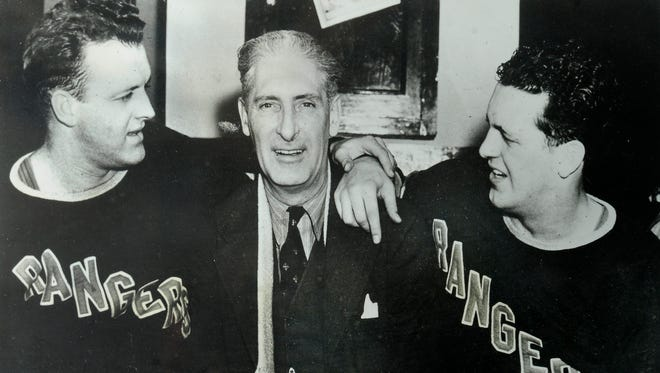 This photo of hockey legend Lester Patrick and his two sons hangs in the Nashville homes of Christine Castillo and Gar Vallone.