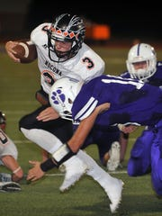Jacksboro's Payton Laake (10) gets low to tackle Nocona Indians quarterback Jeremy James in first quarter action Friday night at Tigers Stadium.