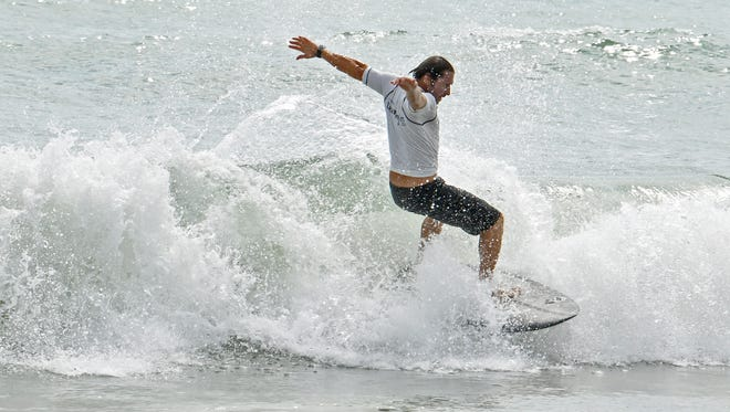 Scenes from Sunday at the 2018 Cocoa Beach Easter Pro/Am Surfing Festival held at Lori Wilson Park. The event included a dog surfing competition to benefit the Brevard Humane Society.
