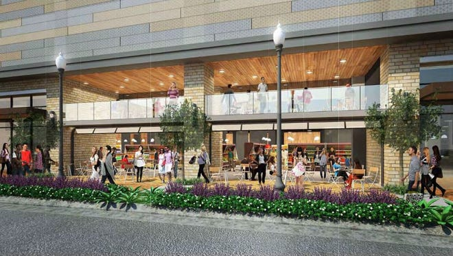 Plans for the design of the Whole Foods building calls for roll-up windows for outdoor dining.