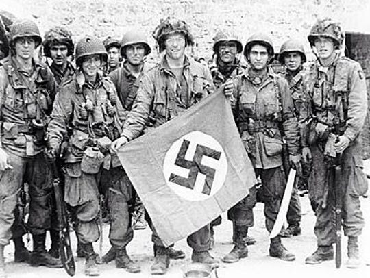 A 101st Airborne Division soldier poses with a captured