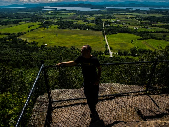 David Garbose, co-owner of the Mt. Philo Inn in Charlotte, looks out over Champlain Valley from the top of the state park that the his inn was named for, a view that he claims would have been harmed had a solar project been allowed to proceed off U.S. 7 roughly a half a mile or more away from the peak.