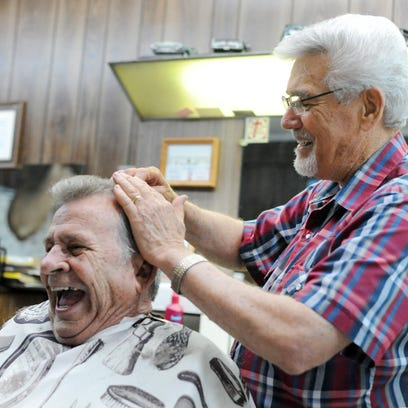 Hattiesburg barber Bob Morrow cuts Sammy James' hair