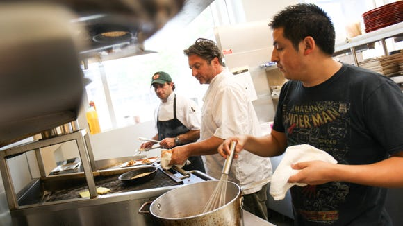 Cocina Lolo chef and owner Bryan Sikora (middle) with Matt Mascitti (left) and Pedro Flores prepare dishes that will be served during Delaware Dines Out next week.