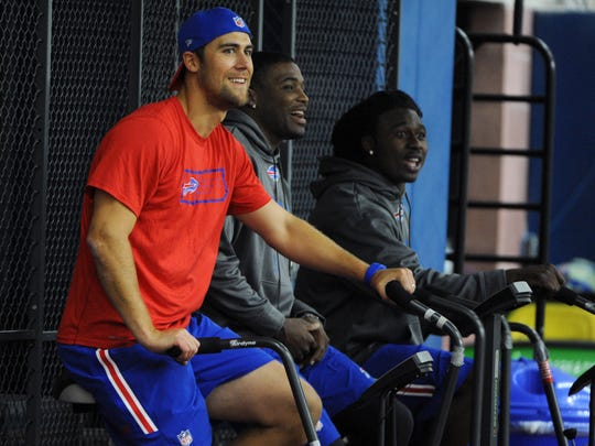 Bills quarterback Matt Cassel, left, safety Aaron Williams, center, and wide reciever Sammy Watkins, right, ride stationary bikes during a voluntary offseason conditioning session April 6, 2015, in Orchard Park.