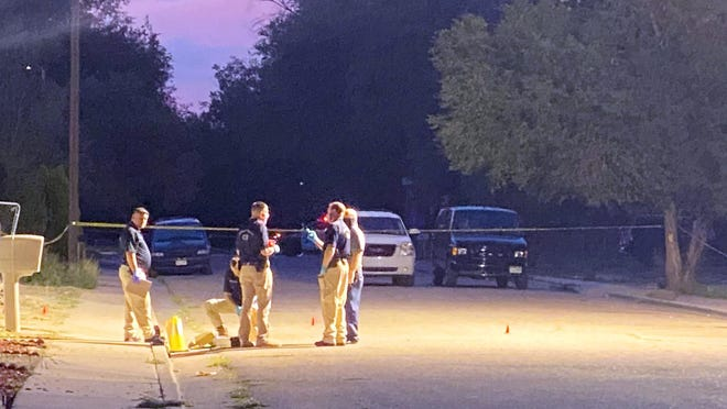 Law enforcement personnel investigate at the scene of an officer-involved shooting early Wednesday where one  woman was killed by Pueblo Police Department officers during a home invasion.
