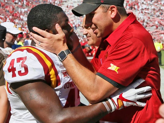Iowa State coach Matt Campbell, right, celebrates with linebacker Tymar Sutton.