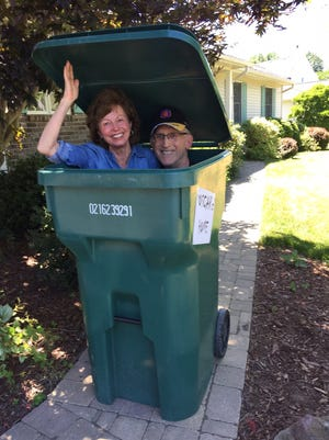 Shirley and Craig Stratton demonstrate the size of their new Spencerport village-issued, 96-gallon trash can.