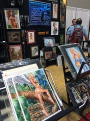 A shot of artist Monte Michael Moore's Maverick Arts booth at Gen Con.