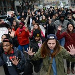 Protesters rally against police brutality and racism by marching with their hands up in downtown Pittsburgh on Thursday.
