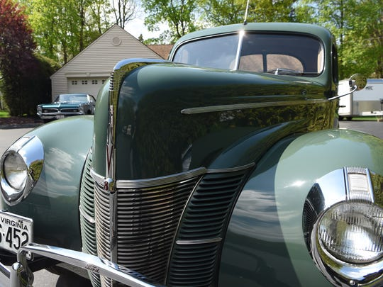 A 1940 Ford Deluxe coupe, one of the cars Kenny Pascoe has collected.