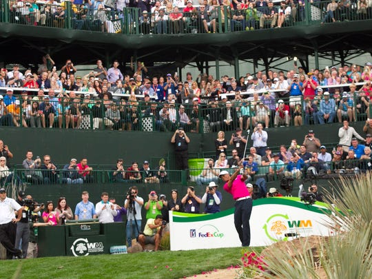 Tiger Woods hits a tee shot on the 16th hole during