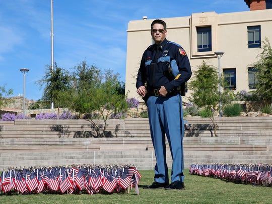 El Paso Police Lt. John Schneider, stands between the