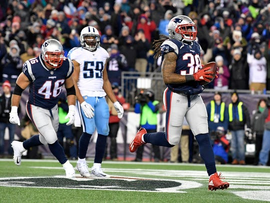 Patriots running back Brandon Bolden (38) runs in for