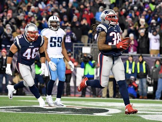 Patriots running back Brandon Bolden (38) runs in for
