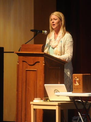 Brigette Henschel shares her story of her daughter Amalia's death due to a heroin overdose at a heroin summit Wednesday night at the Fond du Lac High School's Performing Arts Center.