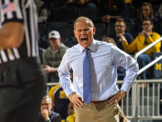 Michigan coach John Beilein reacts to a foul called
