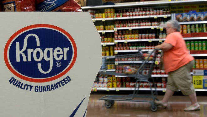 A shopper moves through a Kroger Co. supermarket in Newport, Ky. in this 2010 file photo