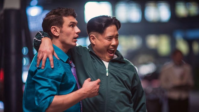 """Dave Skylark (James Franco) and Kim Jong Un (Randall Park) become best buds in """"The Interview."""""""