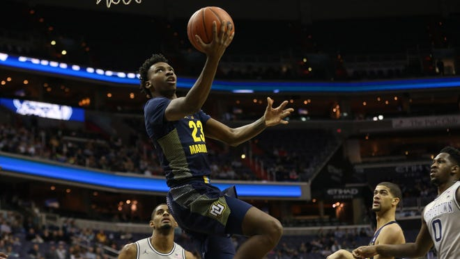 Jajuan Johnson, who scored 14 points, was one of the few bright spots in Marquette's loss to Georgetown on Saturday.