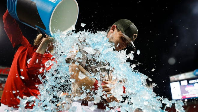 Scooter Gennett is showered with ice after hitting four home runs, including a grand slam, vs. the Cardinals last week.