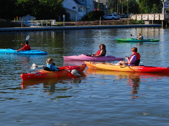 Kayakers prepare to paddle the Pine River in St. Clair.