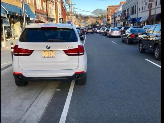 A photograph posted on the Facebook group, Millburn 'Complete' Insanity, shows an example of poor parking on a new spot in Millburn's downtown.