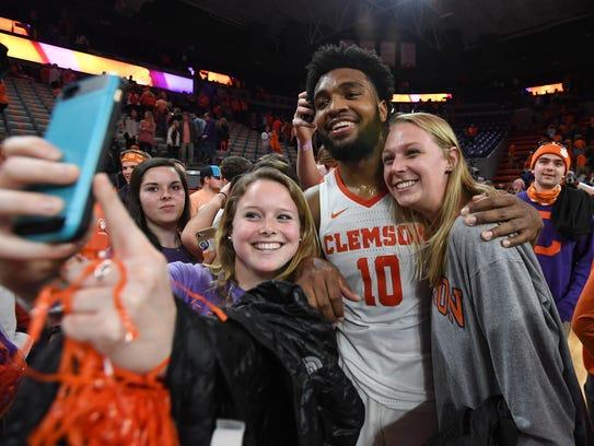Clemson guard Gabe DeVoe (10) celebrates with students