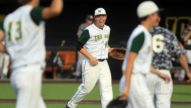 West High's Alex Aller jokes with teammates after their win over Regina at Duane Banks Field on Tuesday.