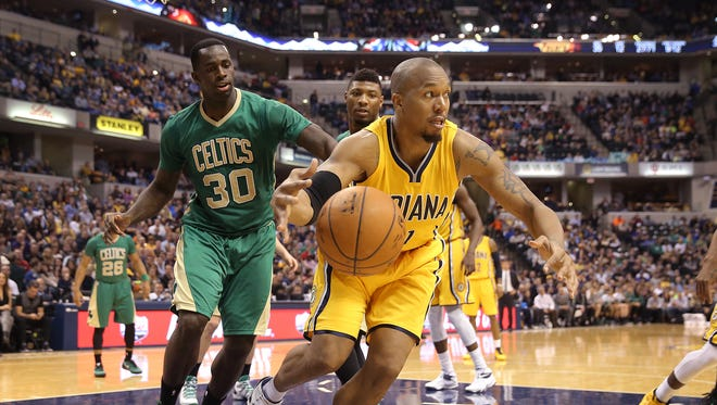 Indiana Pacers forward David West (21) clears the ball from the lane in the second half of their game Saturday, March 14, 2015, evening at Bankers Life Fieldhouse. The Pacers lost to the Celtics 89-93.