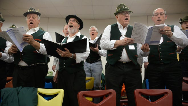 """Cold Spring Area Maennerchor members from left: Willy Wilson, Dan Grube, Jack Maus, and Brad Schott sing """"O Holy Night"""" during a dress rehearsal Wednesday at Rocori High School."""