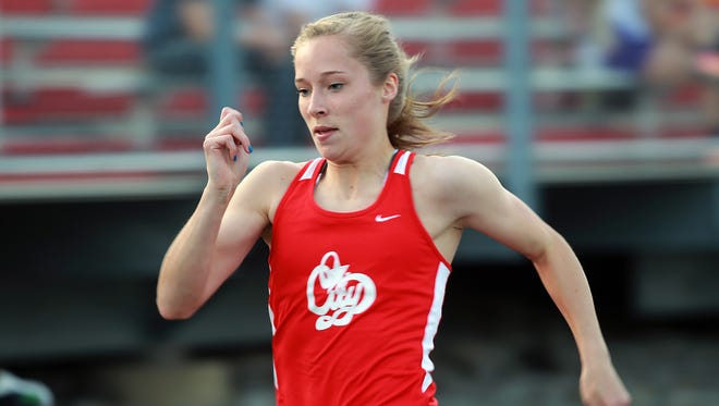 City High's Sarah Plock competes in the 100 meter dash during the Forwald/Coleman Relays at City High on Thursday, April 16. On Saturday Plock claimed the 400-meter hurdles title at the Drake Relays for the third time.