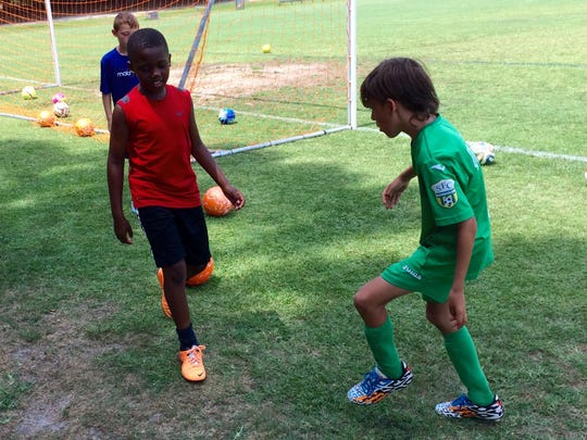 A few young players at the Matrix Soccer Academy kick